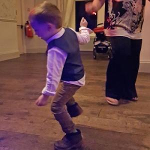 Dancing child at wedding